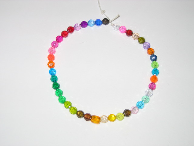 8mm Facet beads on clear string